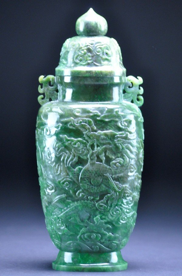 5: A SPINACH GREEN JADE CARVING OF DRAGON VASE AND COVE