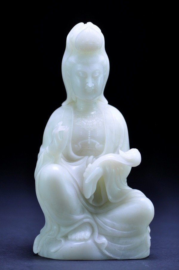 12: A WHITE JADE CARVING OF GUANYIN.