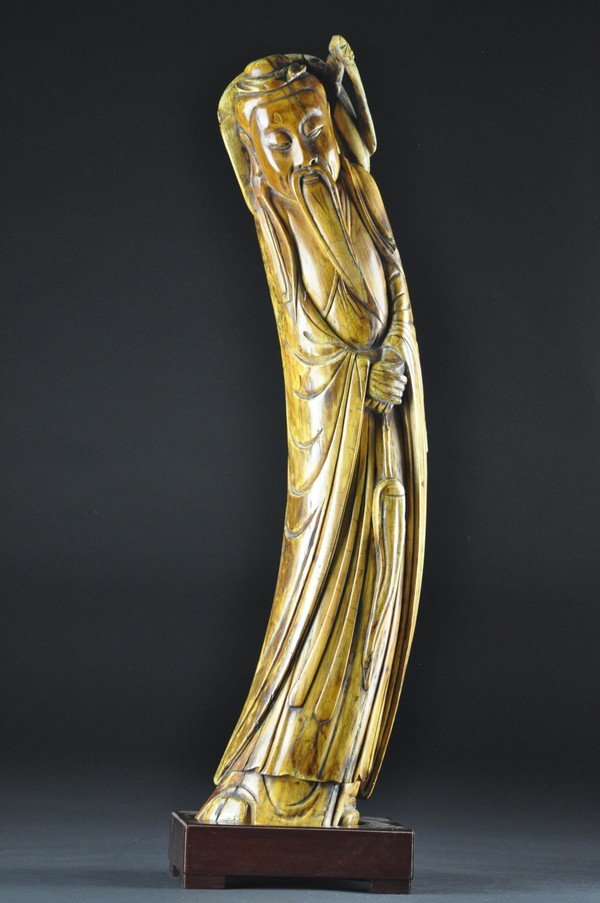 4: A FINE IVORY CARVING OF LU DONG PING.