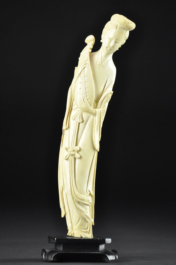 6: AN IVORY CARVING OF FEMALE.