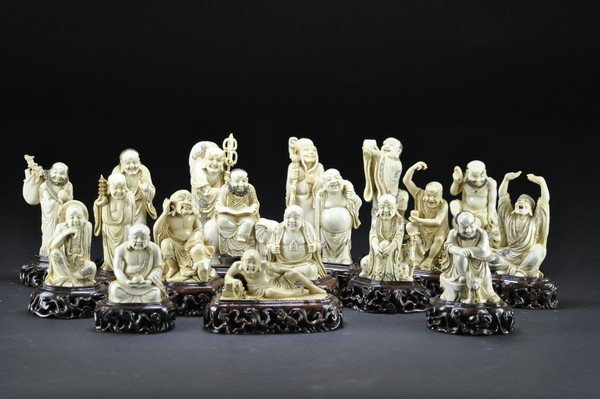 10: A CARVED IVORY SET OF EIGHTEEN LUOHAN .