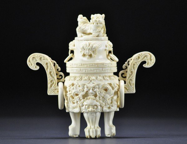 11: A PIECED IVORY COVERED CENSER.20 CENTURY.