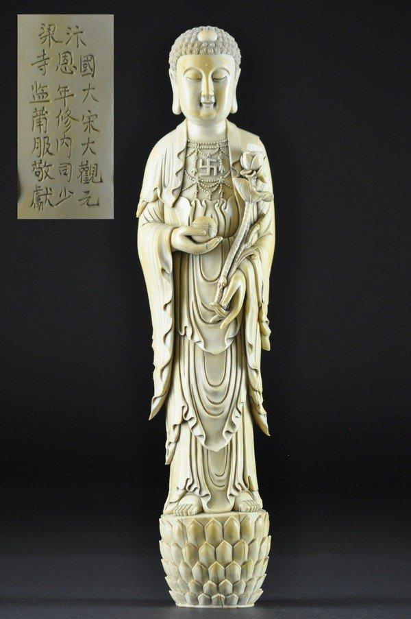 14: A MING STYLE IVORY FIGURE OF BUDDHA .