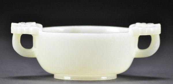 87: A WHITE JADE CARVING OF BOWL.