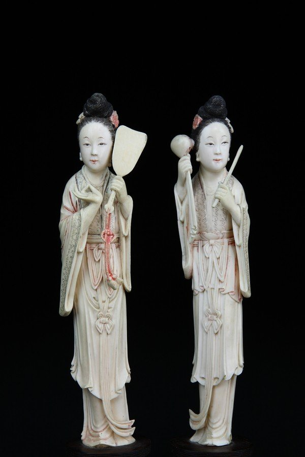 12: A PAIR OF COLORED IVORY BEAUTIES