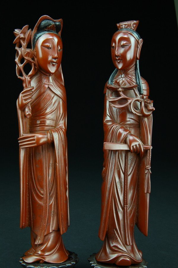 24: A PAIR OF RED LACQUER FIGURES