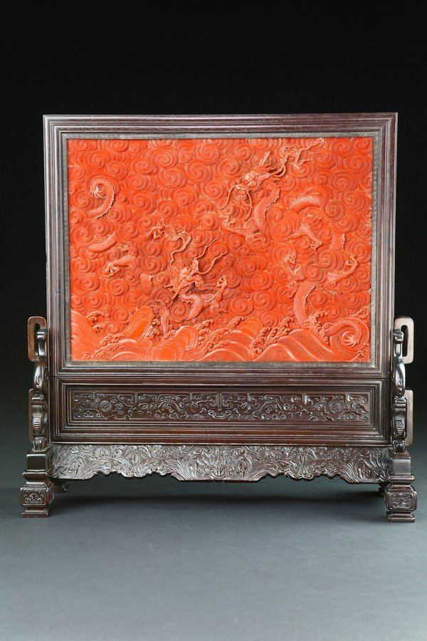 46: A QIANLONG STYLE ZITAN AND CARVED RED LACQUER TABLE