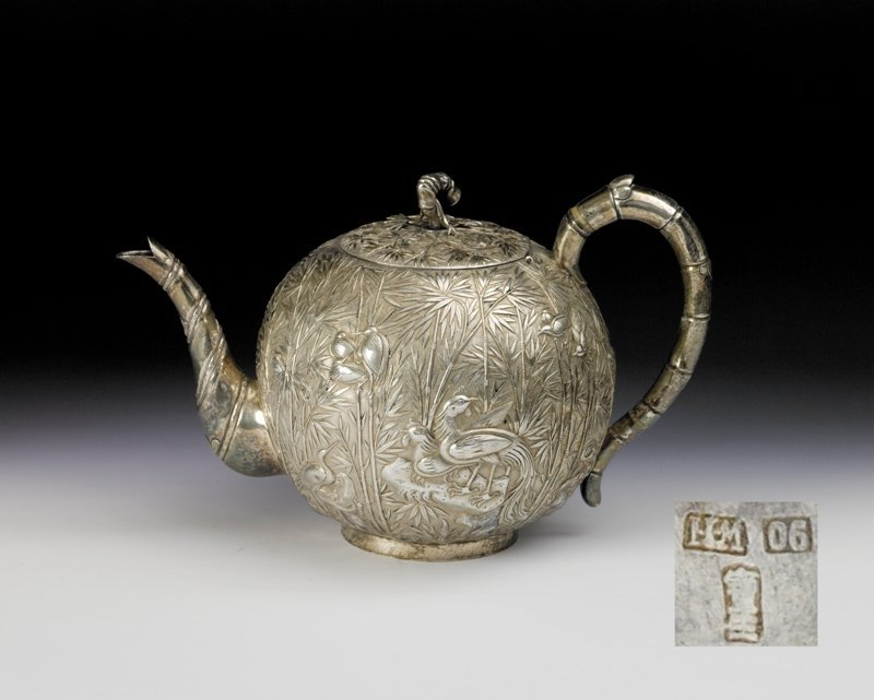 2: A silver carved teapot and cover, 19th Century
