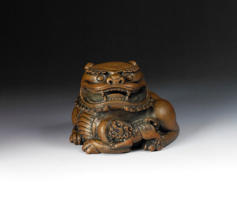 12: A bamboo carving of lion group, 18th Century