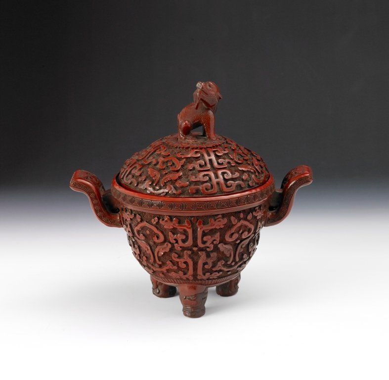 16: A Chinese carved cinnabar lacquer censer and cover,