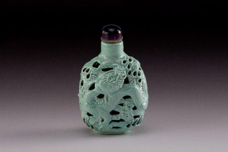 6: A carved green glazed molded porcelain snuff bottle,