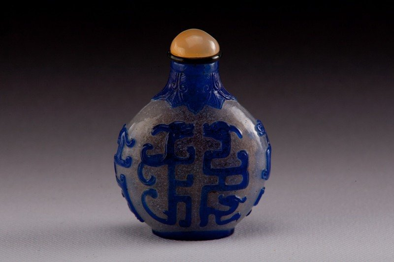 12: A blue overlay white glass snuff bottle, 19TH CENTU