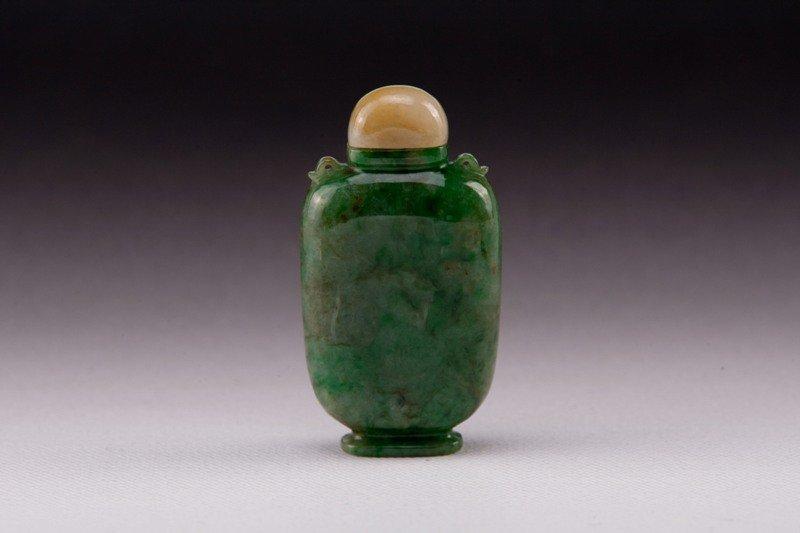 23: A carved jadeite snuff bottle,