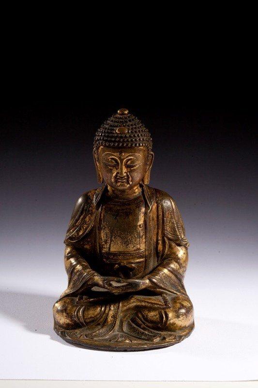 184: A gilt bronze figure of Buddha, MING DYNASTY