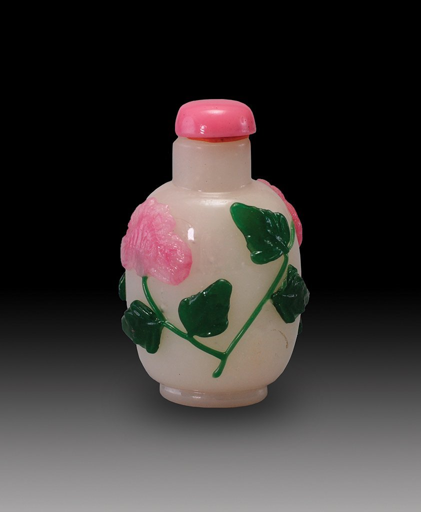 A CARVED PINK-GREEN -OVERLAY GLASS BOTTLE