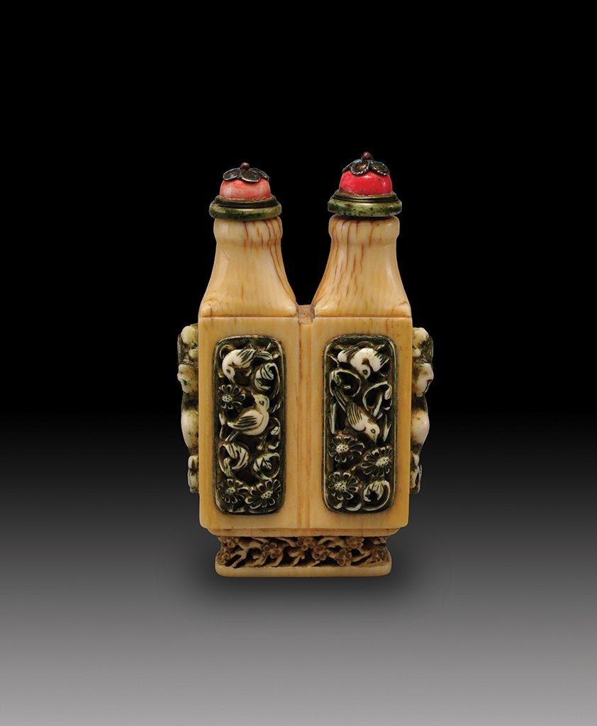 A CARVED IVORY SNUFF BOTTLE