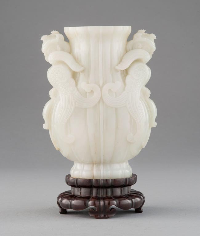 A WHITE JADE CARVING OF PHOENIX VASE