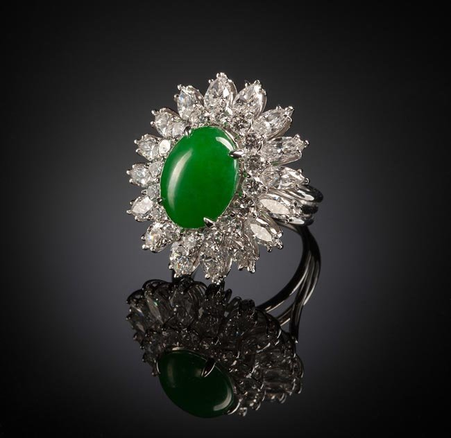A JADEITE JADE AND DIAMOND PLATINUM RING