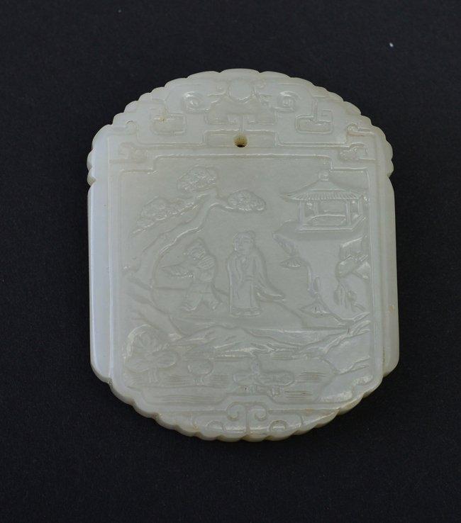 A WHITE JADE 'FIGURE' PENDANT