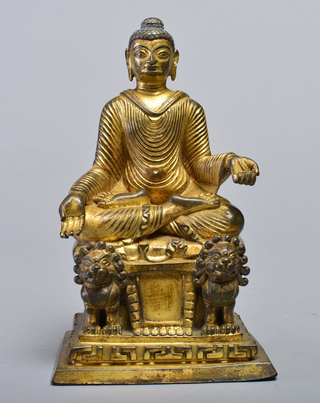 A GILT-BRONZE FIGURE OF BUDDHA SAKYAMUNI