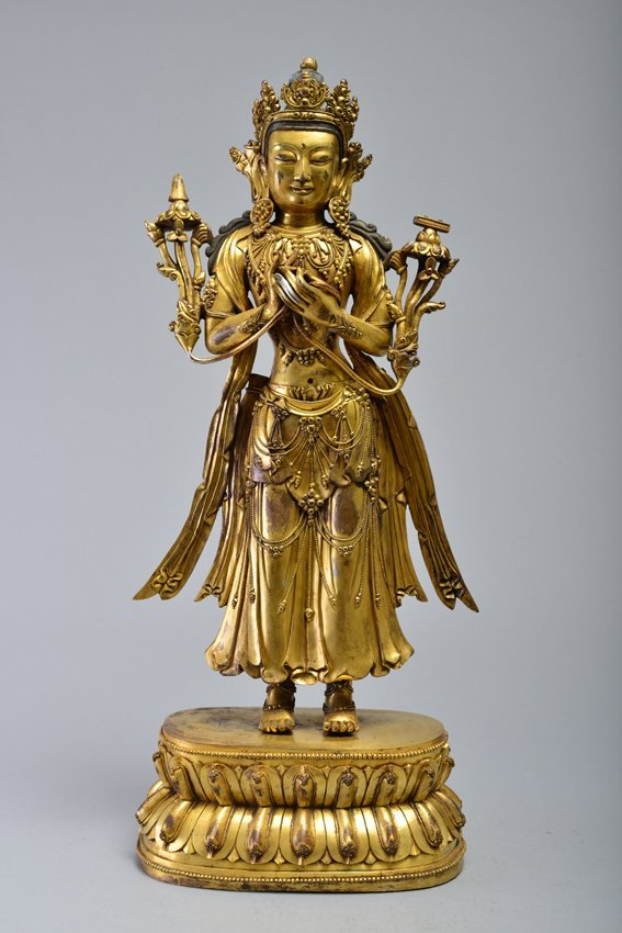 A GILT-BRONZE FIGURE OF AVALOKITESVARA