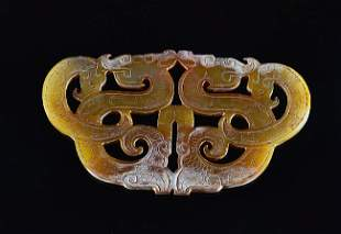 A CHINESE ARCHAIC CELADON YELLOW JADE PENDANT