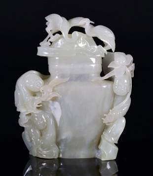 A WHITE JADE CARVING OF VASE AND COVER