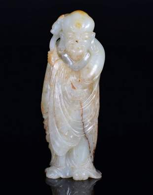 A WHITE JADE CARVING OF LUOHAN