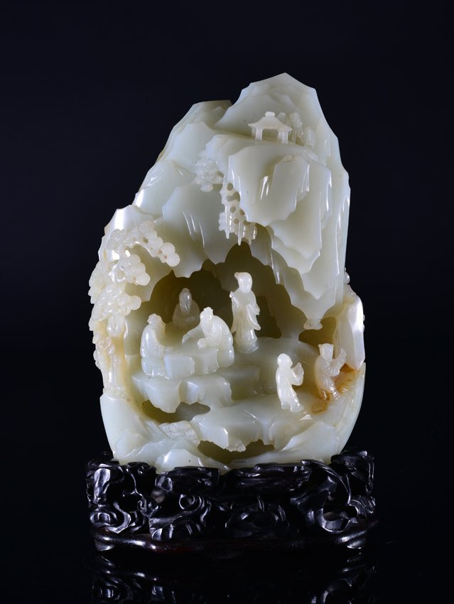 A CARVED WHITE JADE 'LANDSCAPE AND FIGURE' MOUNTAIN