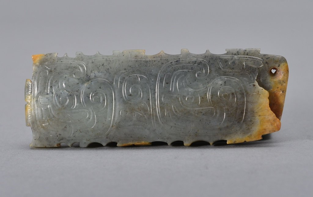 A RECTANGULAR JADE PLAQUE DECORATED WITH TWO MYTHICAL
