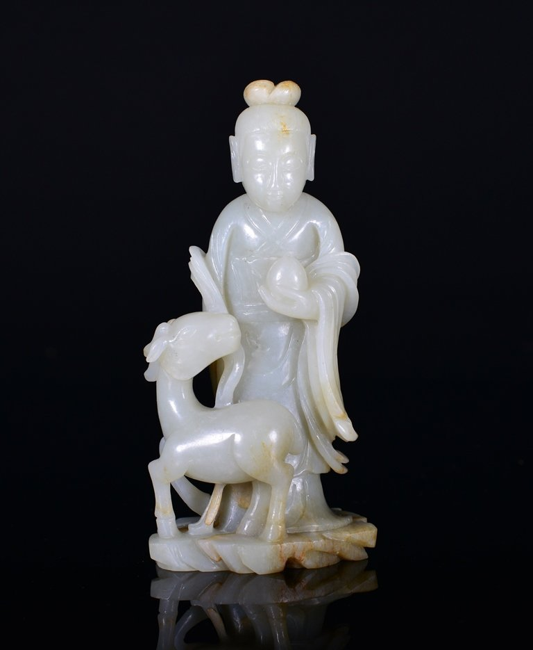 A WHTE JADE CARVING OF STANDING BEAUTY
