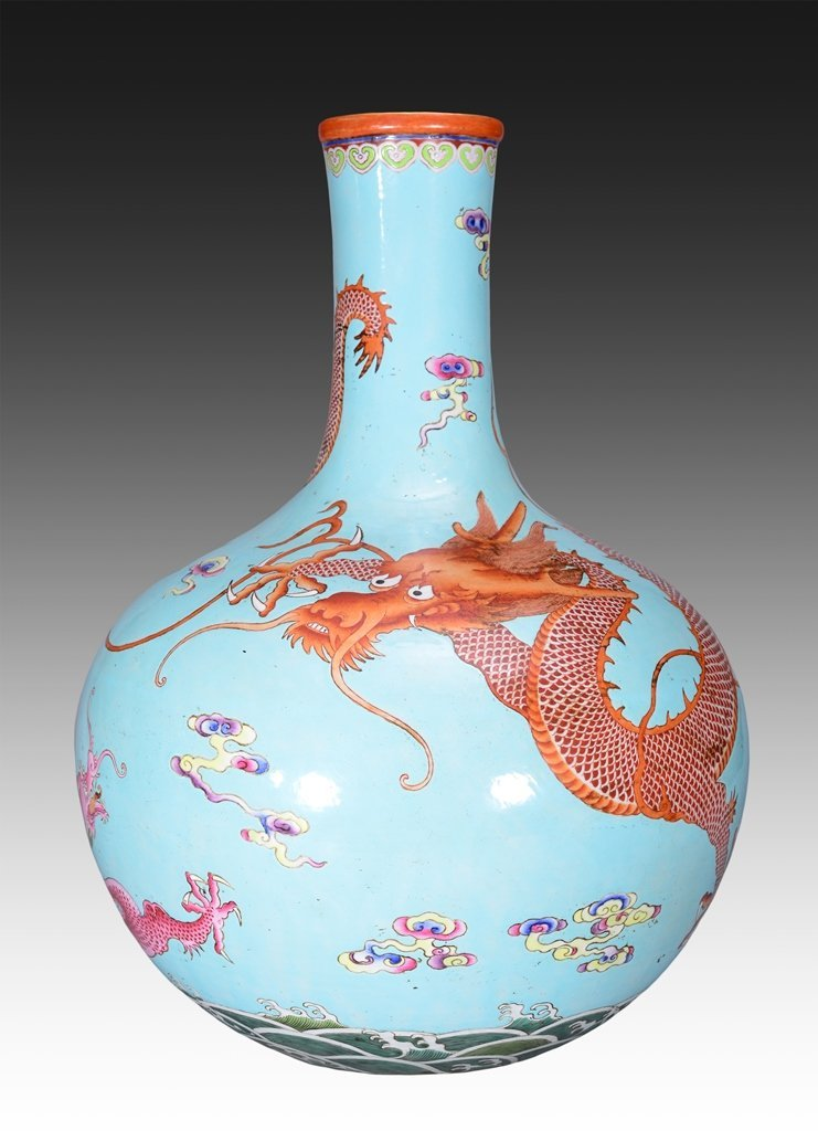 A VERY RARE LARGE FAMILLE ROSE TURQUOISE-GROUND BOTTLE