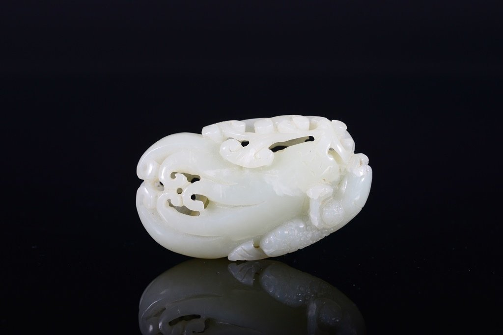 A SMALL WHITE JADE CARVING