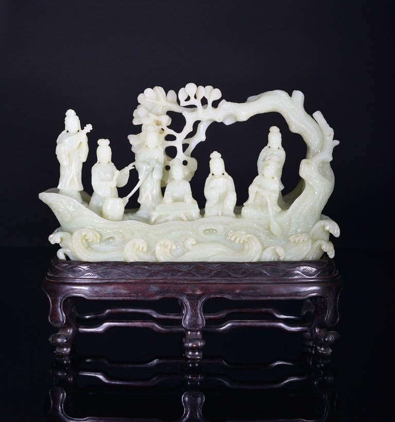 A LARGE WHITE JADE CARVING OF BEAUTY'S BOAT.