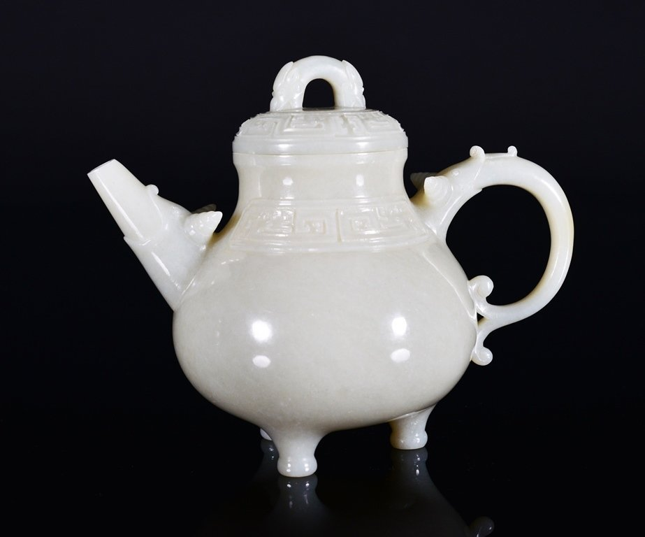 A CARVED WHITH JADE TEAPOT