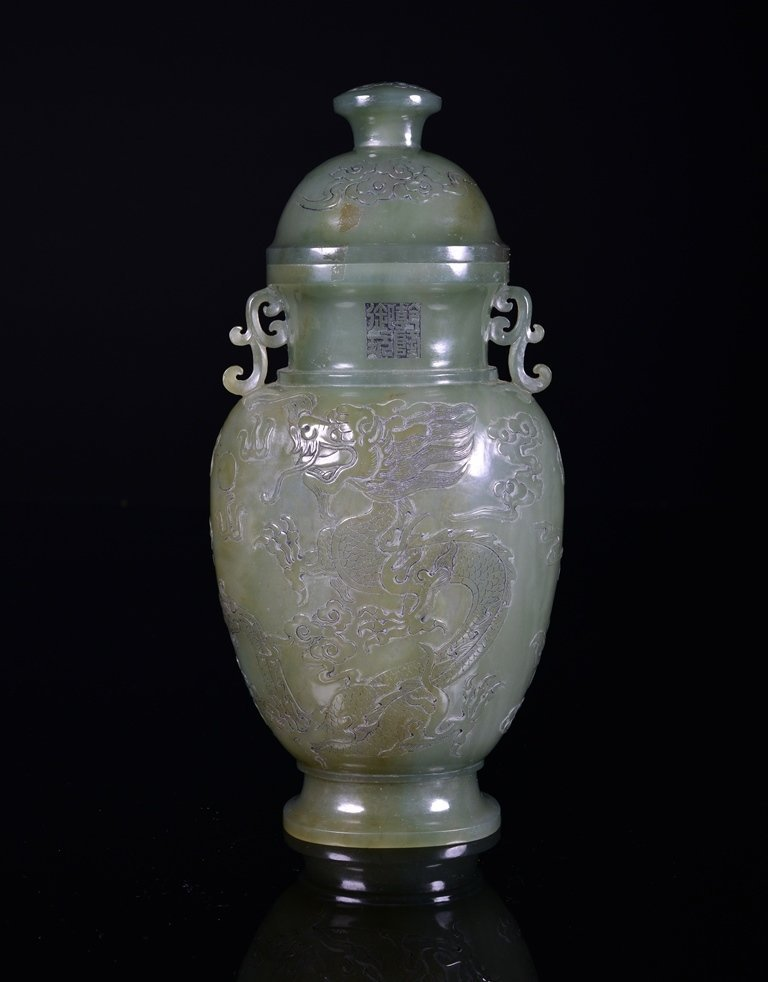 A CELADON JADE CARVING OF DRAGON VASE AND COVER
