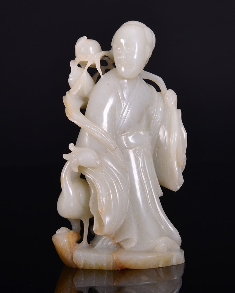 A WHITE JADE CARVING OF MAGU AND PHOENIX