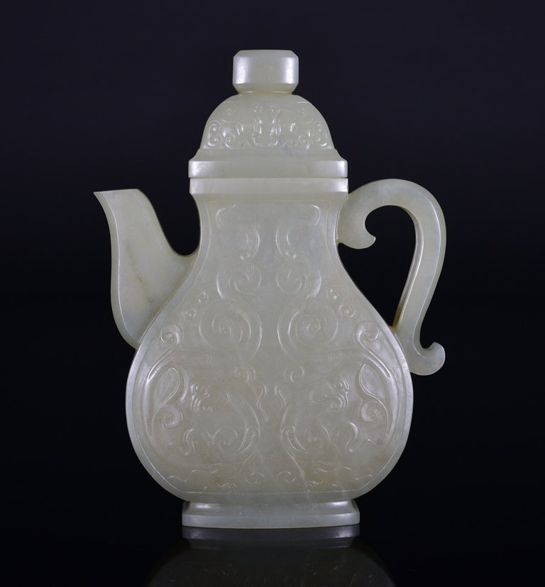 A CARVED WHITE JADE EWER AND COVER