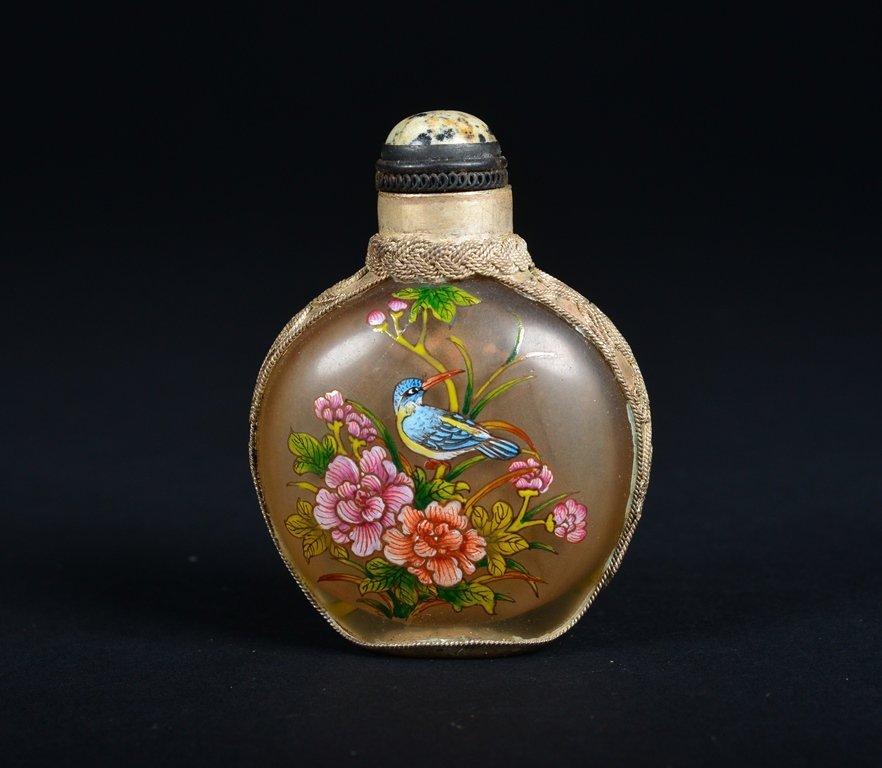 A GLASS-MOUNTED ENAMELLED SILVER SNUFF BOTTLE