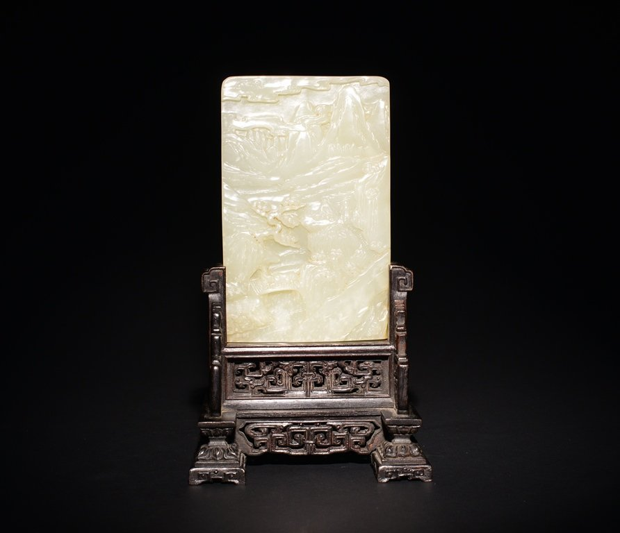 A CARVED WHITE JADE SCREEN
