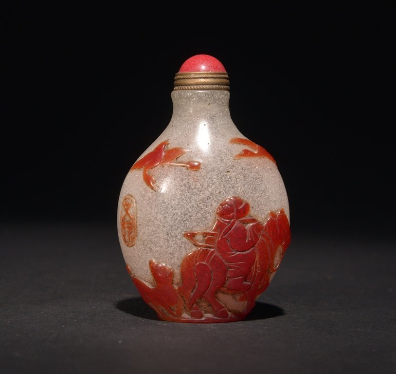A CARVED RED-OVERLAY GLASS SNUFF BOTTLE