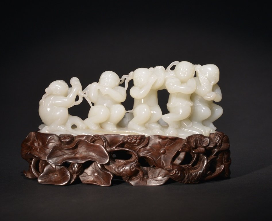 A WHITE JADE CARVING OF BOY'S GROUP
