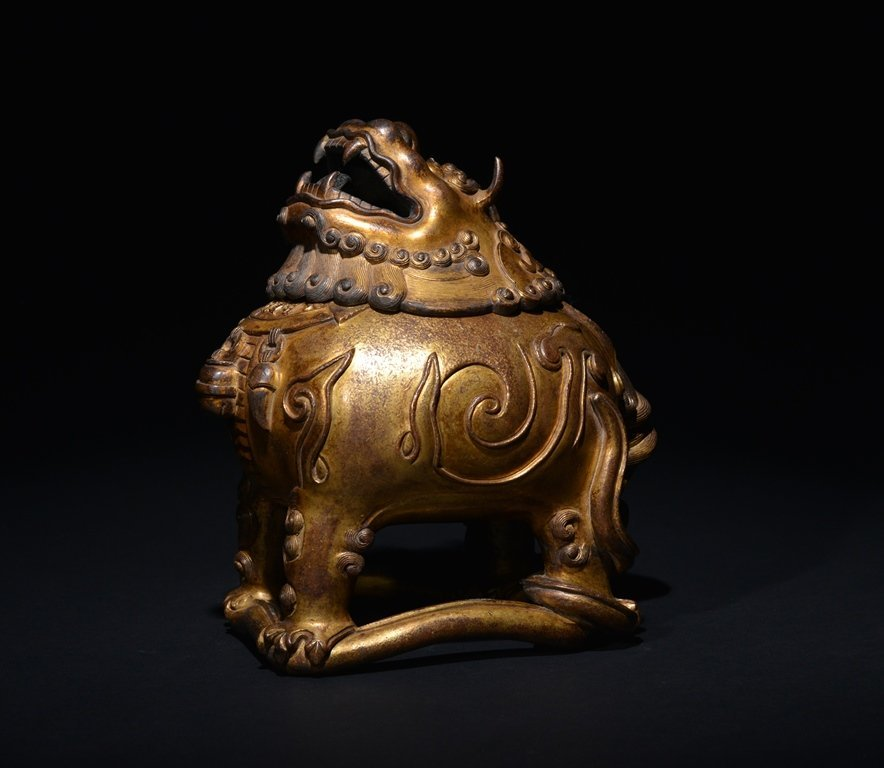 A GILT -BRONZE INCENSE BURNER