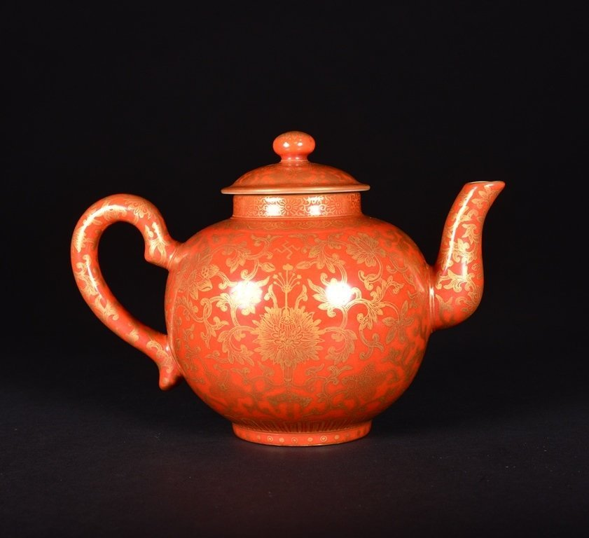 A CORAL-GROUND GILT-INLAID TEAPOT AND COVER