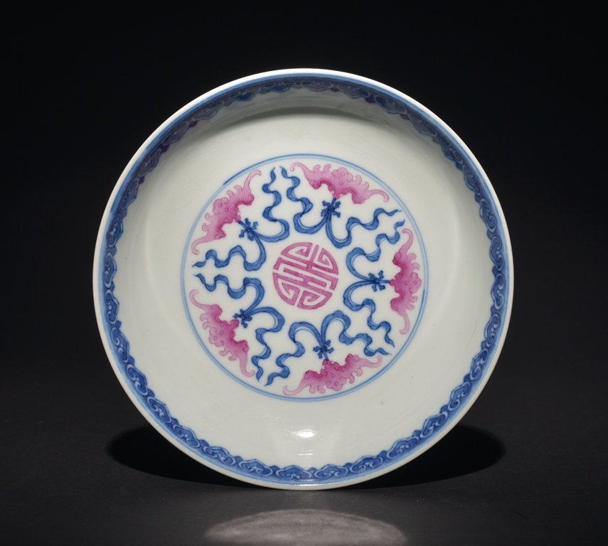 A COPPER-RED BLUE AND WHITE DISH