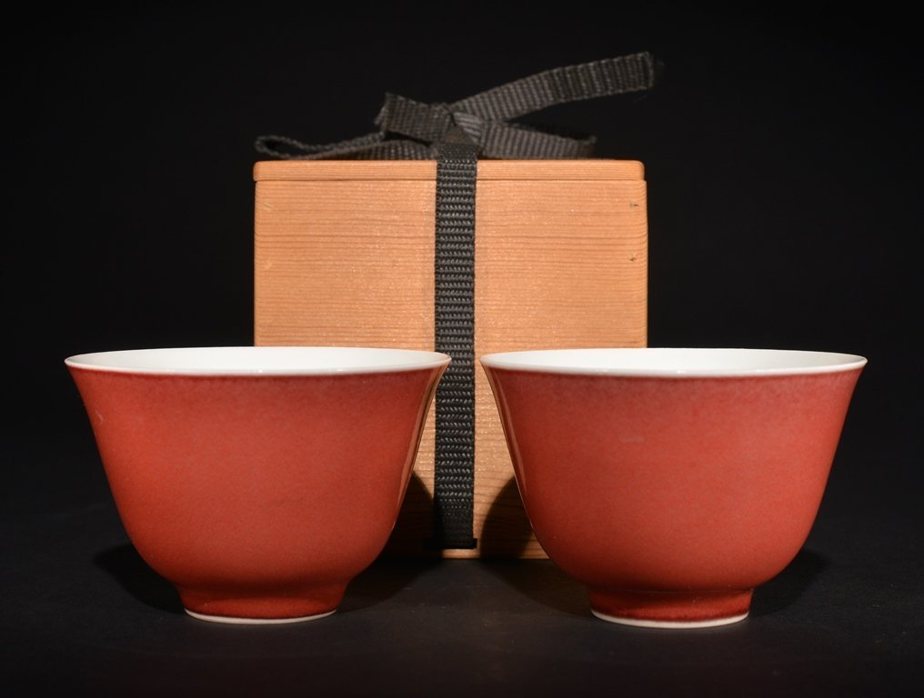 A PAIR OF COPPER-RED CUPS