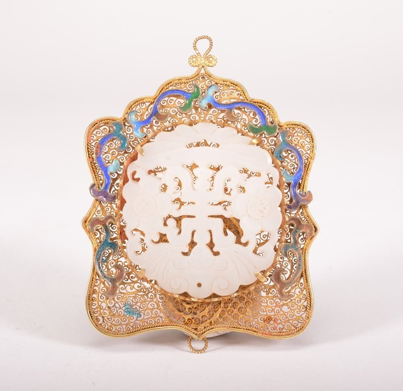 A GOLD-INLAID WHITE JADE PENDANT