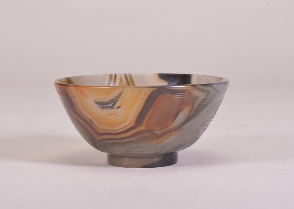A SMALL CARVED AGATE BOWL