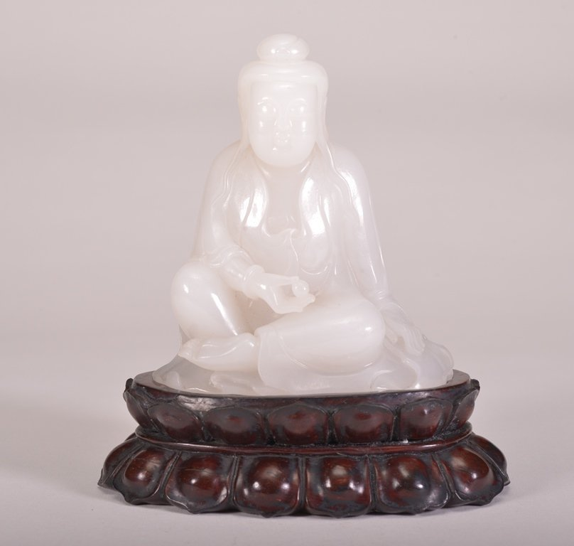 A WHITE JADE CARVING OF GUANYIN