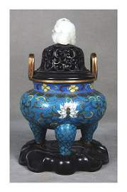 348: A cloisonne tripod incense burner with a cover an